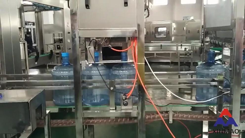 XINMAO QGF-300 20L filling line